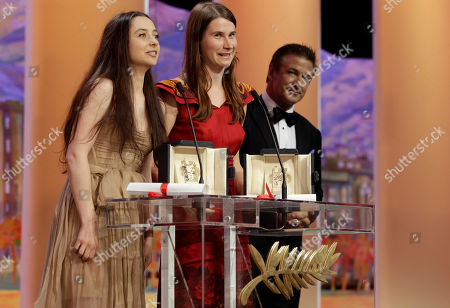 Cristina Flutur, Cosmina Stratan, Alec Baldwin From left, actresses Cosmina Stratan and Cristina Flutur are jointly presented the Best Actress award for Beyond the Hills, actor Alec Baldwin seen on the right, during the awards ceremony at the 65th international film festival, in Cannes, southern France