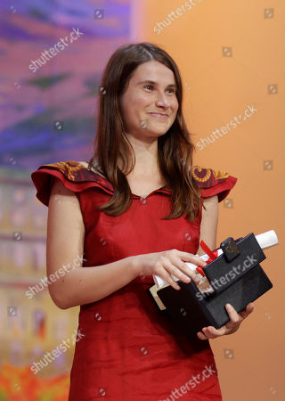 Cristina Flutur Actress Cristina Flutur receives the award for Best Actress for 'Beyond the Hills' during the awards ceremony at the 65th international film festival, in Cannes, southern France