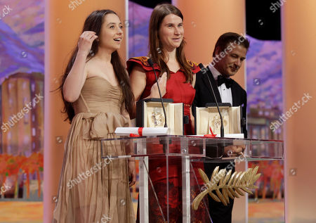 Cosmina Stratan, Cristina Flutur, Alec Baldwin Actresses Cosmina Stratan, left, and Cristina Flutur both receive the award for Best Actress for 'Beyond the Hills', presented by actor Alec Baldwin, right, during the awards ceremony at the 65th international film festival, in Cannes, southern France