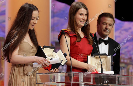 Cristina Flutur, Cosmina Stratan, Alec Baldwin From left, actresses Cosmina Stratan and Cristina Flutur are jointly presented the Best Actress award for Beyond the Hills, actor Alec Baldwin is seen on the right, during the awards ceremony at the 65th international film festival, in Cannes, southern France