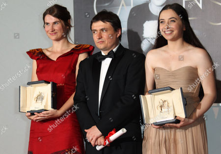 Cristian Mungiu, Cristina Flutur, Cosmina Stratan Director Cristian Mungiu, center, and actresses Cristina Flutur, left, and Cosmina Stratan pose with their awards during a photo call for the Best Director and Best Actress award for Beyond the Hills at the 65th international film festival, in Cannes, southern France