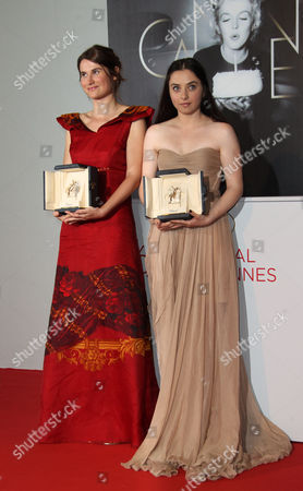 Cristina Flutur, Cosmina Stratan Actresses Cristina Flutur, left, and Cosmina Stratan pose with their awards during a photo call for the Best Actress award for Beyond the Hills at the 65th international film festival, in Cannes, southern France
