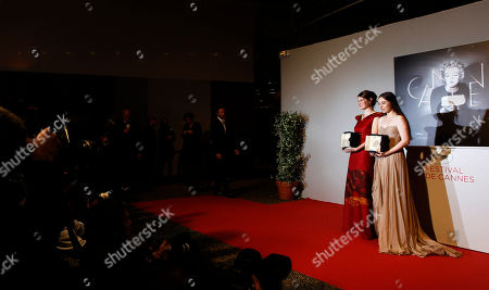 Cristina Flutur, Cosmina Stratan Actresses Cristina Flutur, left, and Cosmina Stratan pose with a jointly presented the Best Actress award for Beyond the Hills during a photo call at the 65th international film festival, in Cannes, southern France