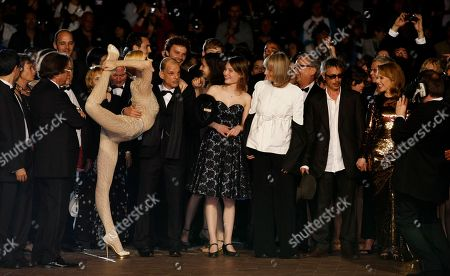 Kylie Minogue, Leos Carax, Edith Scob, Elise Lhomeau, Denis Lavant From second right, actors Kylie Minogue, director Leos Carax, actors Edith Scob, Elise Lhomeau, Denis Lavant and an unidentified performer arrive for the screening of Holy Motors at the 65th international film festival, in Cannes, southern France