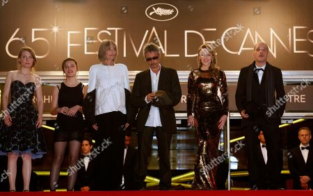 Elise Lhomeau, Jeanne Disson, Edith Scob, Leos Carax, Kylie Minogue, Denis Lavant From left, actors Elise Lhomeau, Jeanne Disson, Edith Scob, director Leos Carax, actors Kylie Minogue and Denis Lavant arrive for the screening of Holy Motors at the 65th international film festival, in Cannes, southern France
