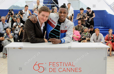 Juan Andres Arango, Luis Carlos Guevara Director Juan Andres Arango, left, and actor Luis Carlos Guevara pose during a photo call for La Playa DC at the 65th international film festival, in Cannes, southern France
