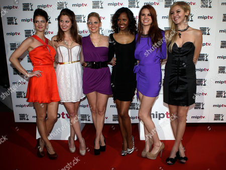 """Left to right, US actresses,Tiffany Brouwer, Christine Donion, Nikki Griffin, Shani Pride, Catherine Annet and Madison Dylan, pose for photographers as they launch """"Femme Fatales """" during the MIPTV, International Television Programme Market, in Cannes, southern France. Femme Fatales is a sexy, thrilling anthology series about powerful, sexy and dangerous women inspired by and styled in the tradition of pulp stories, film noir and graphic novels"""