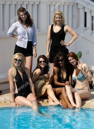 """Left to right sitting, US actresses, Madison Dylan, Tiffany Brouwer, Shani Pride, Catherine Annet, stand up Nikki Griffin and Christine Donion pose for photographers as they launch """"Femme Fatales """" during the MIPTV, International Television Programme Market, in Cannes, southern France. Femme Fatales is a sexy, thrilling anthology series about powerful, sexy and dangerous women inspired by and styled in the tradition of pulp stories, film noir and graphic novels"""