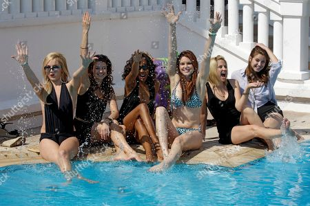 """Left to right, US actresses, Madison Dylan, Tiffany Brouwer, Shani Pride, Catherine Annet, Nikki Griffin and Christine Donion pose for photographers as they launch """"Femme Fatales """" during the MIPTV, International Television Programme Market, in Cannes, southern France. Femme Fatales is a sexy, thrilling anthology series about powerful, sexy and dangerous women inspired by and styled in the tradition of pulp stories, film noir and graphic novels"""