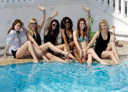 """Left to right,US actresses, Christine Donion, Madison Dylan, Tiffany Brouwer, Shani Pride, Catherine Annet, and Nikki Griffin pose for photographers as they launch """"Femme Fatales """" during the MIPTV, International Television Programme Market, in Cannes, southern France. Femme Fatales is a sexy, thrilling anthology series about powerful, sexy and dangerous women inspired by and styled in the tradition of pulp stories, film noir and graphic novels"""