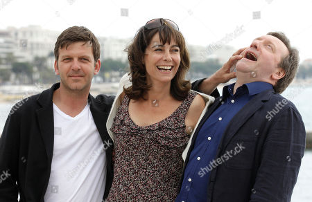 "Left to right, Welsh actor Jason Hughes, British actress Fiona Dolman and British actor Neil Dudgeon, pose for photographers as they launch ""Midsomer Murders"", Inspector Barnaby tv series during the MIPTV, International Television Programme Market, in Cannes, southern France"