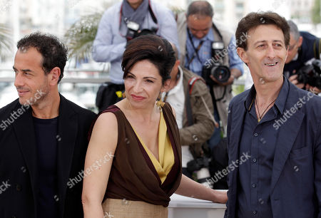 Matteo Garrone, Loredana Simioli, Nando Paone Director Matteo Garrone, left, and actors Loredana Simioli and Nando Paone pose during a photo call for Reality at the 65th international film festival, in Cannes, southern France
