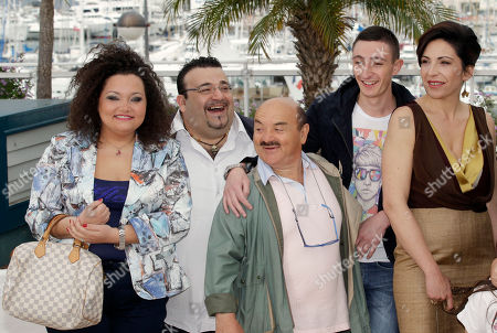 Giuseppina Cervizzi, Nello Iorio, Ciro Petrone Loredana Simioli From left actors, Giuseppina Cervizzi, Nello Iorio, an unidentified person, centre, actors Ciro Petrone and Loredana Simioli pose during a photo call for Reality at the 65th international film festival, in Cannes, southern France