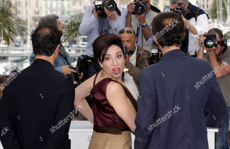 Matteo Garrone, Loredana Simioli, Nando Paone Director Matteo Garrone, left, actors Loredana Simioli and Nando Paone pose during a photo call for Reality at the 65th international film festival, in Cannes, southern France