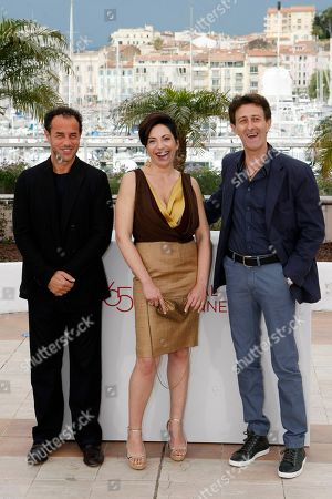 Matteo Garrone, Loredana Simioli, Nando Paone Director Matteo Garrone, left, actors Loredana Simioli, and Nando Paone pose during a photo call for Reality at the 65th international film festival, in Cannes, southern France
