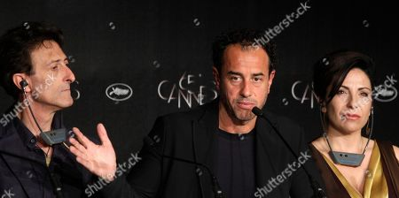 Nando Paone, Matteo Garrone, Loredana Simioli Actor Nando Paone, left, director Matteo Garrone and actress Loredana Simioli attend a press conference for Reality at the 65th international film festival, in Cannes, southern France