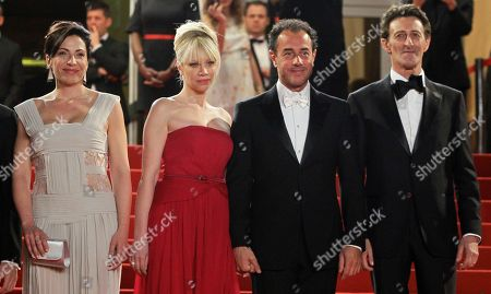 Loredana Simioli, left, director Matteo Garrone, second from right, and Nando Paone, right, arrive for the screening of Reality at the 65th international film festival, in Cannes, southern France
