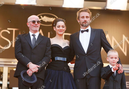 Jacques Audiard, Marion Cotillard, Armand Verdure, Matthias Schoenaertes From left director Jacques Audiard and actors Marion Cotillard, Matthias Schoenaerts and Armand Verdure arrive for the screening of Rust and Bone at the 65th international film festival, in Cannes, southern France