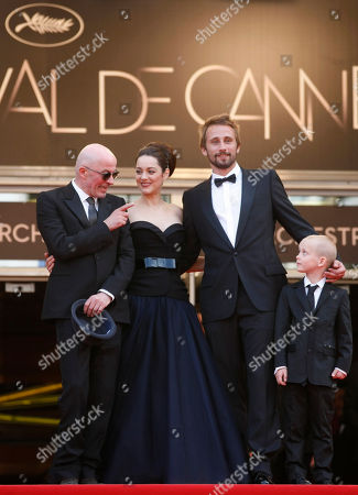 Jacques Audiard, Marion Cotillard, Matthias Schoenaerts, Armand Verdure Cast from left, Jacques Audiard, Marion Cotillard, Matthias Schoenaerts and Armand Verdure stand at the top of the steps during the screening of Rust and Bone at the 65th international film festival, in Cannes, southern France