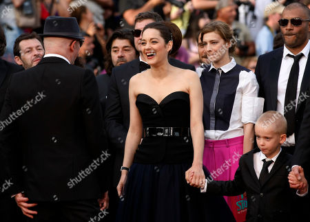 Jacques Audiard, Marion Cotillard, Armand Verdure Director Jacques Audiard, left, actors Marion Cotillard, center, and Armand Verdure, right, arrive for the screening of Rust and Bone at the 65th international film festival, in Cannes, southern France