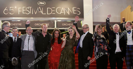 Thierry Fremaux, actors Paul Brannigan, Gary Maitland, William Ruane, Jasmin Riggins, Siobhan Reilly, Ken Loach, Paul Laverty, Charlie Maclean From left Cannes Film Festival artistic director Thierry Fremaux, actors Paul Brannigan, Gary Maitland, William Ruane, Jasmin Riggins, Siobhan Reilly, director Ken Loach, unidentified person, actors Paul Laverty and Charlie Maclean arrive for the screening of The Angel's Share at the 65th international film festival, in Cannes, southern France