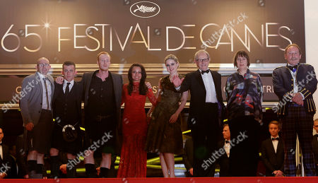 Gary Maitland, Paul Brannigan, William Ruane, Jasmin Riggins, Siobhan Reilly, Ken Loach, Charlie Maclean From left actors, Gary Maitland, Paul Brannigan, William Ruane, Jasmin Riggins, Siobhan Reilly, director Ken Loach, unidentified person and actor Charlie Maclean arrive for the screening of The Angel's Share at the 65th international film festival, in Cannes, southern France