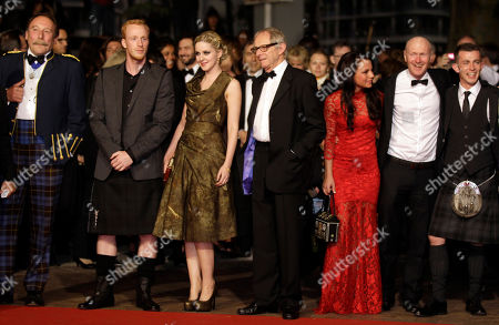 From left, actors Charlie Maclean, William Ruane, Siobhan Reilly, director Ken Loach, Jasmin Riggins, Paul Laverty and Paul Brannigan pose on the red carpet for the screening of The Angels' Share at the 65th international film festival, in Cannes, southern France