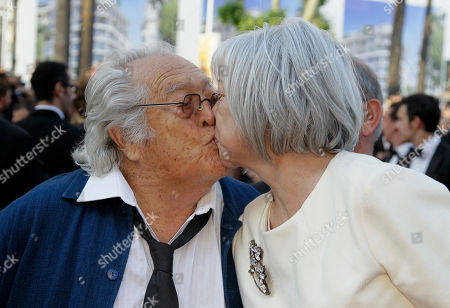 Georges Lautner Director Georges Lautner, left, kisses an unidentified person as they arrive for the screening of The Paperboy at the 65th international film festival, in Cannes, southern France