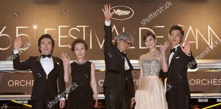 Baek Yoon-sik, Youn yuh-jung, Im Sang-soo, Kim Hyo-jin, Kim Kang-woo From left, actors Baek Yoon-sik, Youn yuh-jung, director Im Sang-soo, actors Kim Hyo-jin and Kim Kang-woo arrive for the screening of The Taste of Money at the 65th international film festival, in Cannes, southern France