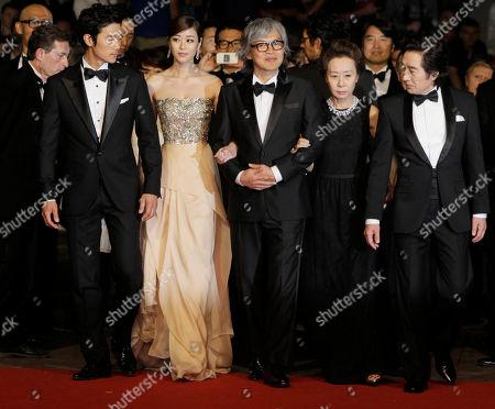 Baek Yoon-sik, Youn yuh-jung, Im Sang-soo, Kim Hyo-jin, Kim Kang-woo From left, actors Kim Kang-woo, Kim Hyo-jin, director Im Sang-soo, actors Youn yuh-jung and Baek Yoon-sik arrive for the screening of The Taste of Money at the 65th international film festival, in Cannes, southern France