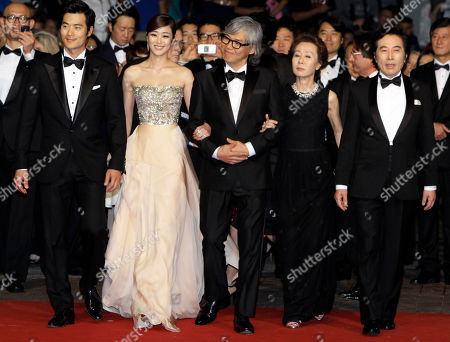 Stock Image of Baek Yoon-sik, Youn yuh-jung, Im Sang-soo, Kim Hyo-jin, Kim Kang-woo From left, actors Kim Kang-woo, Kim Hyo-jin, director Im Sang-soo, actors Youn yuh-jung and Baek Yoon-sik arrive for the screening of The Taste of Money at the 65th international film festival, in Cannes, southern France