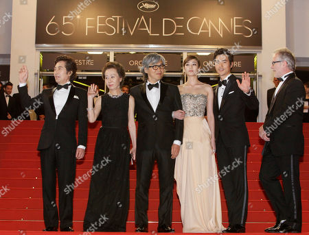 Stock Photo of Baek Yoon-sik, Youn yuh-jung, Im Sang-soo, Kim Hyo-jin, Kim Kang-woo From left, actors Baek Yoon-sik, Youn yuh-jung, director Im Sang-soo, actors Kim Hyo-jin and Kim Kang-woo arrive for the screening of The Taste of Money at the 65th international film festival, in Cannes, southern France