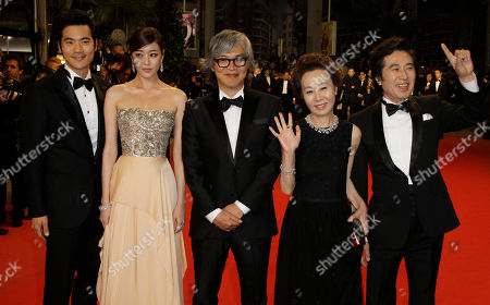 Stock Picture of Baek Yoon-sik, Youn yuh-jung, Im Sang-soo, Kim Hyo-jin, Kim Kang-woo From left, actors Kim Kang-woo, Kim Hyo-jin, director Im Sang-soo, actors Youn yuh-jung and Baek Yoon-sik arrive for the screening of The Taste of Money at the 65th international film festival, in Cannes, southern France