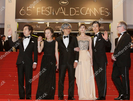 Baek Yoon-sik, Youn yuh-jung, Im Sang-soo, Kim Hyo-jin, Kim Kang-woo From left, actors Baek Yoon-sik, Youn yuh-jung, director Im Sang-soo, actors Kim Hyo-jin and Kim Kang-woo arrive for the screening of The Taste of Money at the 65th international film festival, in Cannes, southern France