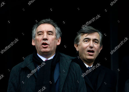 Francois Bayrou, leader of the French centrist Democratic Movement, MODEM and candidate for the 2012 presidential elections, left, and former French Foreign Minister Philippe Douste-Blazy sing the national anthem before the six nations rugby union match between France and England at the Stade de France stadium, in Saint Denis, outside Paris