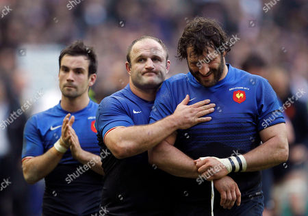 Stock Picture of France's Morgan Parra, left, William Servat, center, and Lionel Nallet react after their six nations rugby union match against England at the Stade de France stadium, in Saint Denis, outside Paris