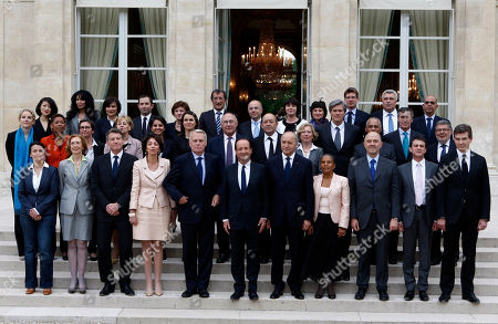 French President Francois Hollande, center, poses with his ministers after the first weekly cabinet cabined with at the Elysee Palace in Paris. From the left fist row are: Housing Minister Cecile Duflot, Environment minister Nicole Bricq, Education Minister Vincent Peillon, Social Affairs minister Marisol Touraine, Prime Minister Jean-Marc Ayrault, President Hollande, Foreign Minister Laurent Fabius, Justice Minister Christiane Taubira, Finance Miister Pierre Moscovici, Interior Minister Manuel Valls, Minister for Productive Recovery Arnaud Montebourg. Second row from the left: Deputy Justice Minister Delphine Batho, Deputy Education minister George Pau-Langevin, Sports Minister Valerie Fourneyron, Public sector minister Marylise Lebranchu, Women's Rights minister Najat Vallaud-Belkacem, Culture Minister Aurelie Filippeti, Labor Minister Michel Sapin Defense Minister Jean-Yves le Drian, Research Minister Genevive Fioraso, Agriculture Minister Stephane le Foll, Minister for Overseas territories Victorin Lurel, Budget Minister Jerome Cahuzac and Minister in charge with Relations with the Parliament Alain Vidalies