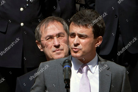 France's new Interior Minister Manuel Valls, right, and outgoing interior minister Claude Gueant, left, are seen during the handover ceremony, in Paris