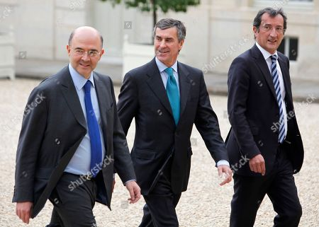 Pierre Moscovici, Jerome Cahuzac, Francois Lamy Newly named Finance Minister Pierre Moscovici, left, Budget Minister Jerome Cahuzac and Minister for Urban Matters Francois Lamy arrive for the first weekly cabinet meeting with new President Francois Hollande, at the Elysee Palace in Paris