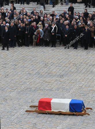 Nicolas sarkozy France's President Nicolas Sarkozy, left, stands with various dignitaries and relatives, looking on the coffin of Raymond Aubrac, during a ceremony to honour the major figure of the World War French Resistance during his funeral in Paris, . Aubrac, who gained fame when he evaded the Nazis in a now-legendary escape led by his equally renowned wife, has died aged 97