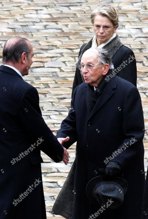 Former French President Jacques Chirac, left, shakes hand with Raymond Aubrac during a ceremony in Paris. Aubrac, one of the last major figures of the French Resistance whose parents died at Auschwitz during World War II, died late . He was 97. Aubrac, who was Jewish and whose birth name was Raymond Samuel, helped set up Liberation-Sud (Liberation South) - one of the first networks of the Resistance against the Nazi occupation of France. In back is former French defense minister Michele Alliot-Marie