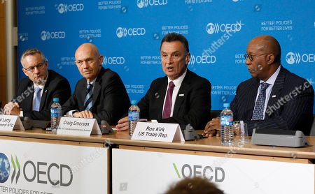 Australian trade minister Craig Emerson, second right, addresses reporters during a joint press conference held at the OECD in Paris, . Others are from left: Canadian trade minister Ed Fast, WTO, World Trade Organisation director general Pascal Lamy and U.S. Trade Representative Ron Kirk, right