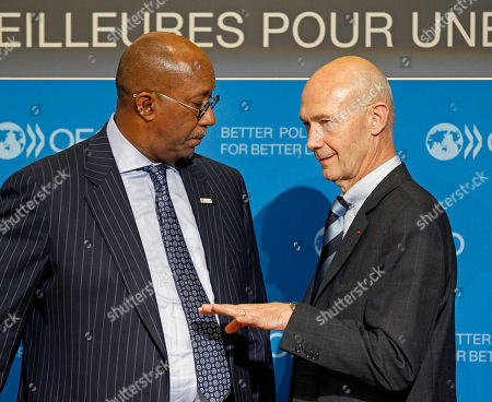 WTO, World Trade Organisation director general Pascal Lamy, right, speaks with U.S. Trade Representative Ron Kirk, prior to a joint press conference held at the OECD in Paris