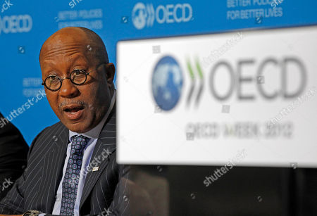 U.S. Trade Representative Ron Kirk, right, addresses reporters during a press conference held at the OECD in Paris