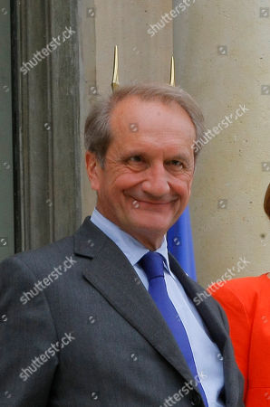 French Defense Minister Gerard Longuet leaves at the end of the weekly cabinet meeting at the Elysee palace in Paris