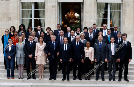 French President Francois Hollande, center, and Prime Minister Jean-Marc Ayrault, 5th left first row, pose with ministers after the first weekly cabinet at the Elysee Palace in Paris. France's government has resigned ahead of a reshuffle that comes 24 hours after President Francois Hollande's Socialists suffered losses in nationwide municipal elections seen as a referendum on his leadership. From the left first row are: Housing Minister Cecile Duflot, Environment minister Nicole Bricq, Education Minister Vincent Peillon, Social Affairs minister Marisol Touraine, Prime Minister Jean-Marc Ayrault, President Hollande, Foreign Minister Laurent Fabius, Justice Minister Christiane Taubira, Finance Miister Pierre Moscovici, Interior Minister Manuel Valls, Minister for Productive Recovery Arnaud Montebourg. Second row from the left: Deputy Justice Minister Delphine Batho, Deputy Education minister George Pau-Langevin, Sports Minister Valerie Fourneyron, Public sector minister Marylise Lebranchu, Women's Rights minister Najat Vallaud-Belkacem, Culture Minister Aurelie Filippeti, Labor Minister Michel Sapin Defense Minister Jean-Yves le Drian, Research Minister Genevive Fioraso, Agriculture Minister Stephane le Foll, Minister for Overseas territories Victorin Lurel, Budget Minister Jerome Cahuzac and Minister in charge with Relations with the Parliament Alain Vidalies