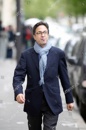 Aquilino Morelle Francois Hollande's political adviser Aquilino Morelle smiles as he walks to a meeting of the Socialist group at the National Assembly in Paris. The French president's top adviser has resigned following allegations of a past conflict of interest, striking a new blow to already unpopular Francois Hollande. Aquilino Morelle - Hollande's political adviser and head of communication staff - announced his resignation Friday, an official in president's office said. Morelle has denied allegations by news website Mediapart of a conflict of interest while he worked for the government pharmaceutical regulator in 2007, while also lobbying for the drug industry. The report also criticized Morelle's supposed lavish lifestyle at a time when the government is making harsh cuts in public spending. Hollande's approval rating has recently hit a new low of 18 percent despite a cabinet reshuffle three weeks ago