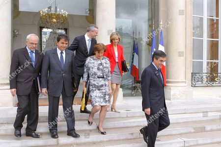 French Prime Minister Francois Fillon, rigth, leaves with his ministers, form left, Veterans Minister, Marc Laffineur, secretary of state for foreign trade, Pierre Lellouche, Agriculture, Food, Fisheries and Land Management Minister, Bruno Le Maire, Solidarity and Social Cohesion Minister, Roselyne Bachelot and Budget Minister, Valerie Pecresse,after his last weekly cabinet meeting as President Nicolas sarkozy was holding his final Cabinet meeting in Elysee Palace, Paris, . Outgoing President Sarkozy is to turn over power to President-elect Francois Hollande on May 15 after 5 years in office