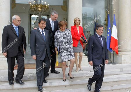 French Prime Minister Francois Fillon, right, leaves with his ministers, form left, Veterans Minister, Marc Laffineur, secretary of state for foreign trade, Pierre Lellouche, Agriculture, Food, Fisheries and Land Management Minister, Bruno Le Maire, Solidarity and Social Cohesion Minister, Roselyne Bachelot and Budget Minister, Valerie Pecresse, after his last weekly cabinet meeting as President Nicolas Sarkozy was holding his final Cabinet meeting in Elysee Palace, Paris, . Outgoing President Sarkozy is to turn over power to President-elect Francois Hollande on May 15 after 5 years in office