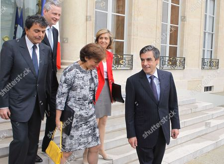 French Prime Minister Francois Fillon, rigth, leaves with his ministers, form left, secretary of state for foreign trade, Pierre Lellouche, Agriculture, Food, Fisheries and Land Management Minister, Bruno Le Maire, Solidarity and Social Cohesion Minister, Roselyne Bachelot and Budget Minister, Valerie Pecresse,after his last weekly cabinet meeting as President Nicolas sarkozy was holding his final Cabinet meeting in Elysee Palace, Paris, . Outgoing President Sarkozy is to turn over power to President-elect Francois Hollande on May 15 after 5 years in office
